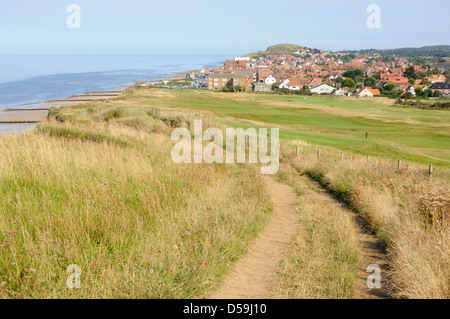Looking east along the top of the cliffs towards the town of Sheringham, Norfolk - Stock Photo