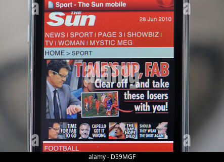 An iPhone diplays the headline 'Time's up, Fab'of British tabloid 'The Sun' after Germany's performance in the - Stock Photo