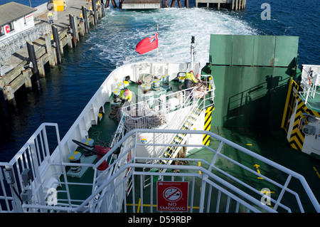 Caledonian MacBrayne Seamen on board the MV Finlaggan departing from Uig Isle of Skye Scotland UK Europe - Stock Photo