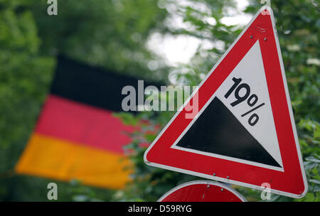 Aroadsign indicates a 19% gradient with a German flag in the background, picture taken in Jocketa, Germany on 1 - Stock Photo