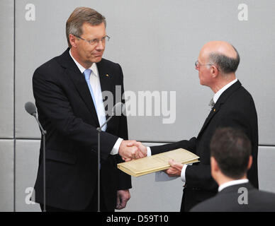 The new German President Christian Wulff (L) receives congratulations from the President of the Bundestag Norbert - Stock Photo