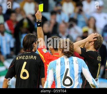 Germany's Thomas Mueller reacts as he is booked with a yellow card by Usbek referee Ravshan Irmatov during the 2010 - Stock Photo