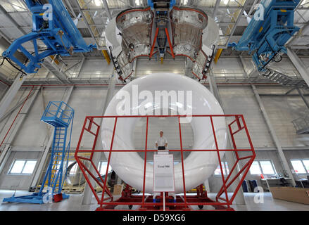 Works on the cover panel of a Rolls-Royce Trent 900 jet engine at the 'N3 Overhaul Services GmbH'  jet engine maintenance - Stock Photo