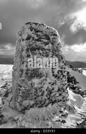 The summit trig point on Moel Hebog in winter - Stock Photo