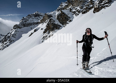 Ski touring above Arolla in Switzerland - Stock Photo