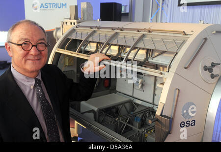 Director General of the European Space Agency (ESA) Jean-Jacques Dordain stands next to a model of the ISS module - Stock Photo