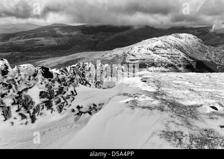 A snowy wall on Moel Hebog in black and white - Stock Photo