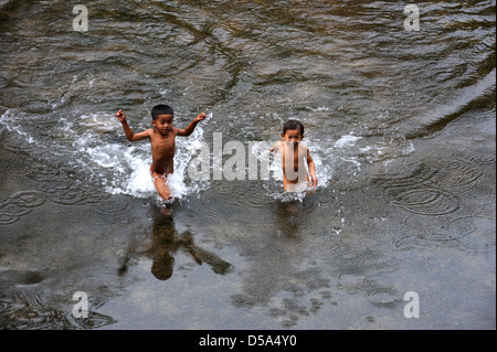 Children on River at the village of Ban Kong Lo on Laos - Stock Photo