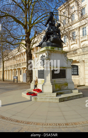 Carlton House Terrace and the Royal Marines Memorial with circular paved area and inscription - Stock Photo