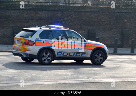 Metropolitan Police car at speed with emergency blue lights - Stock Photo