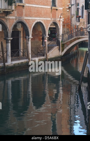 Looking towards Fondementa Piovan, Venice, with reflections in the canal - Stock Photo