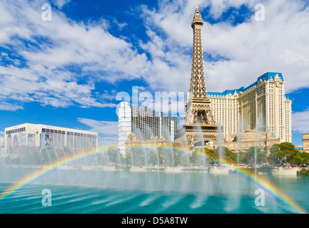 Water fountains and rainbow outside the Bellagio hotel with Paris hotel behind, The Strip, Las Vegas Boulevard South, - Stock Photo