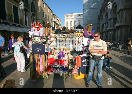 VENICE - OCTOBER 28: Street vendor selling tourist souvenirs on October 28, 2009 in Venice. - Stock Photo
