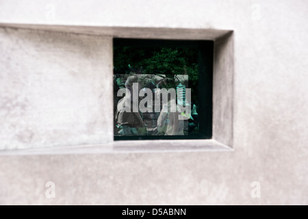 Video in the viewing window of the Memorial to Homosexuals persecuted under the Nazis in Berlin Germany. - Stock Photo