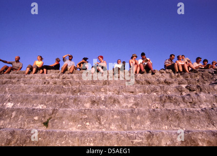 Tourists gather on top of Temple IV (4) of Tikal to see the sunset - Stock Photo
