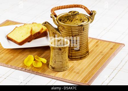 Green tea in tea pot with lemon pound cake - Stock Photo