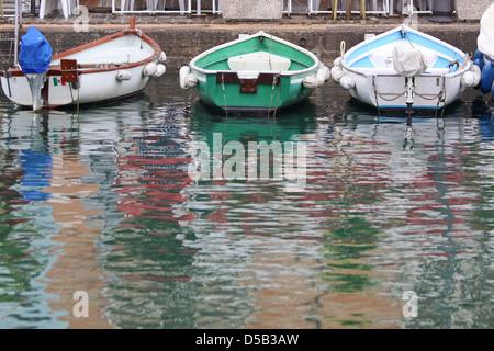 Rowing boats in the harbor of Desenzano on Lake Garda, Region of Brescia, Lombardy, Italy - Stock Photo