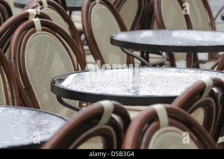 Street cafe on a rainy day in Desenzano on Lake Garda, Region of Brescia, Lombardy, Italy - Stock Photo