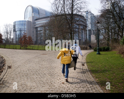 Group of schoolkids running through the Leopoldpark towards the European Union buildings Brussels Belgium - Stock Photo