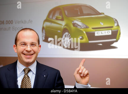 Renault Germany CEO Achim Schaible points on the photo of a Renault Clio at the company's annual press conference - Stock Photo