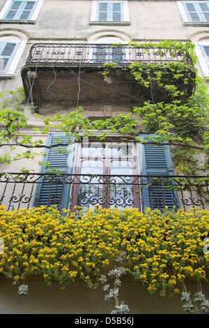 Balcony with rich floral decorations in Desenzano on Lake Garda, Region of Brescia, Lombardy, Italy - Stock Photo