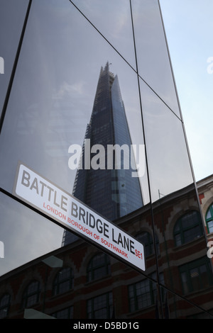 The Shard viewed as a reflection of a building on Battle Bridge Lane - Stock Photo