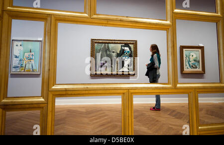 A staff member eyes a work by Pablo Picasso on display at graphics Museum Pablo Picasso Muenster in Muenster, Germany, - Stock Photo