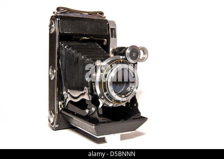 Old-time rusty photo-camera isolated on white background - Stock Photo