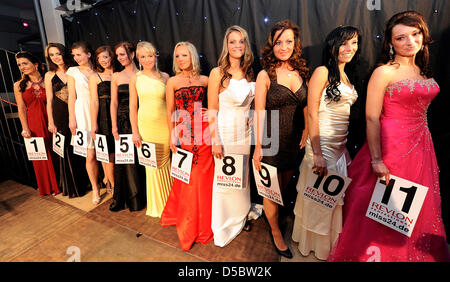 11 young women line up for the beauty pagent election for Miss Brandenburg 2010 at the discotheque Julius in Fuerstenwalde, - Stock Photo