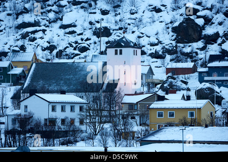 oksfjord church and village during winter norway europe - Stock Photo