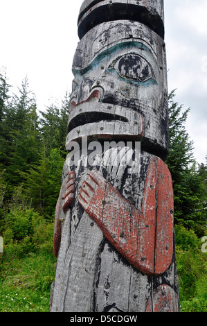 Tlingit totem pole in Kake, Alaska. At 132' it is the tallest properly sanctioned totem pole in the world. - Stock Photo