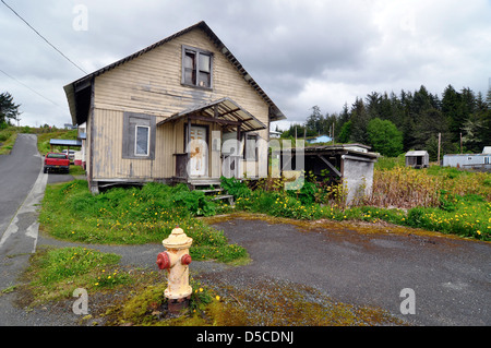 Fire hydrant in front of house in Kake, Alaska. - Stock Photo