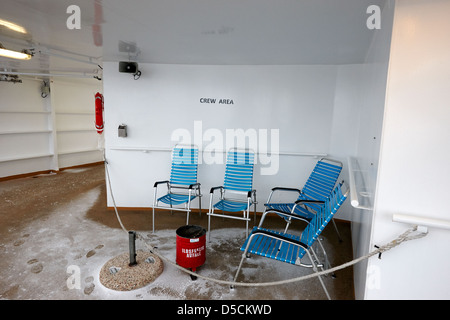 empty ships crew outdoor smoking area in snow on ship norway europe - Stock Photo