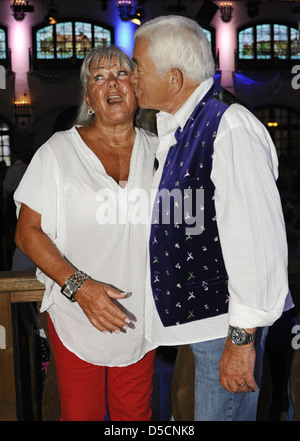 Gus Backus and his wife Heidelore at the Angermaier fashion event at Loewenbraeukeller. Munich, Germany - 01.09.2011 - Stock Photo