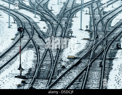 Tracks and switches of the Deutsche Bahn AG, German rail, in the winter.