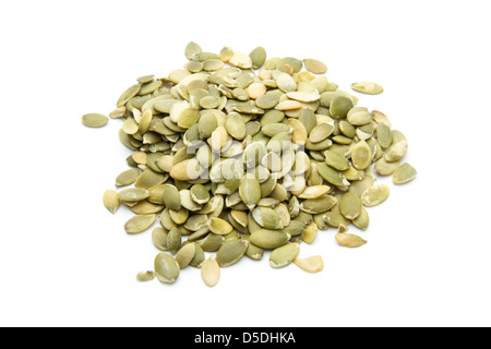 group of pumpkin seeds isolated on white background - Stock Photo