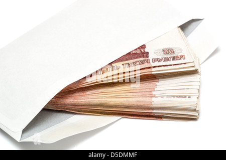 Five thousand Russian banknotes in envelope on white background - Stock Photo