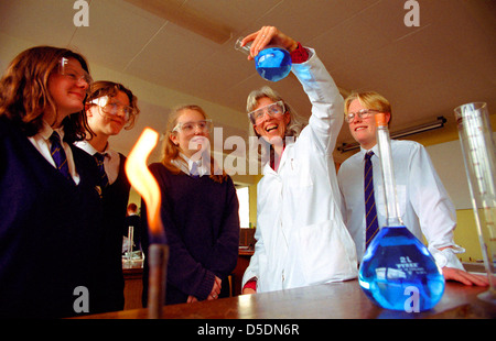 A science teacher with pupils at Colyton Grammar School in Devon. - Stock Photo