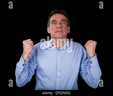 Frustrated Middle Age Business Man Shaking Fists in Anger Black Background - Stock Photo
