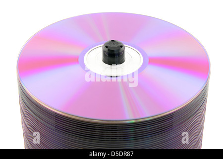Close-up of purple DVDs or CDs on spindle, on white background. No dust. - Stock Photo