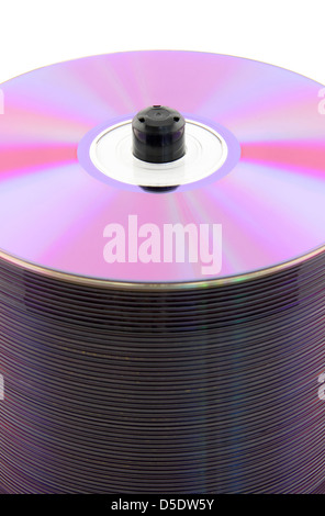 Purple CDs or DVDs on spindle, on white background. No dust. - Stock Photo