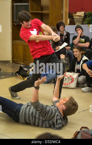 Two high school drama drama students perform improvisational theatre for their classmates in San Clemente, CA. - Stock Photo