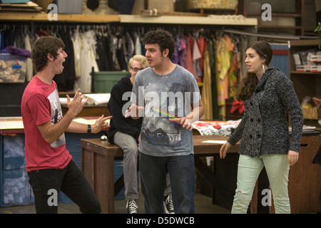 Three high school drama drama students perform improvisational theatre for their classmates in San Clemente, CA - Stock Photo
