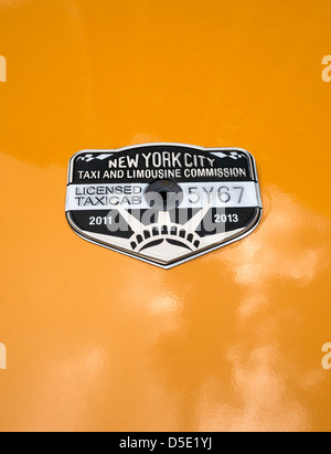 a new york city taxi and limousine commission medallion on a cab is stock photo royalty free. Black Bedroom Furniture Sets. Home Design Ideas