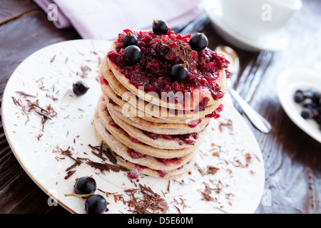 crispy pancakes with berries on top, closeup - Stock Photo