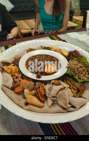 Traditional ethiopian cuisine doro wat injera and curry for Authentic ethiopian cuisine