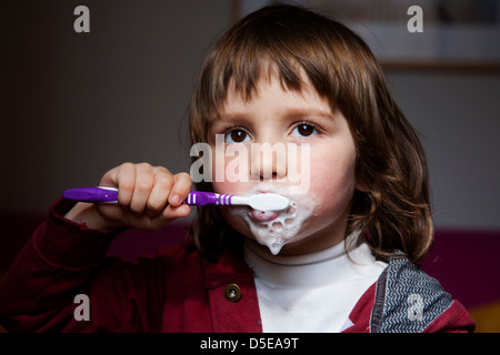 Four year old brushing his teeth - Stock Photo