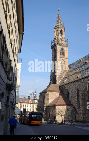 City bus on the street below the cathedral in Bolzano, Italy. - Stock Photo