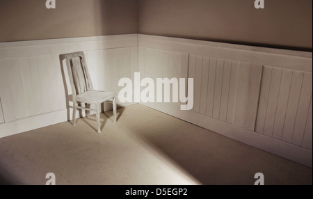 Empty interior with oldfashion chair against wall - Stock Photo