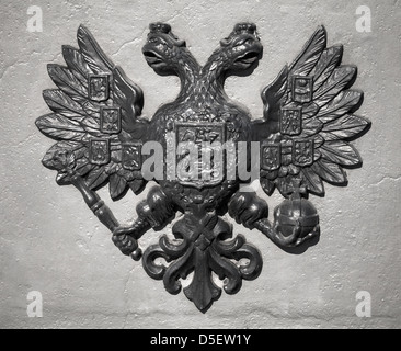 Double Eagle - Emblem of Russia. Ancient black bas-relief on gray vintage wall - Stock Photo